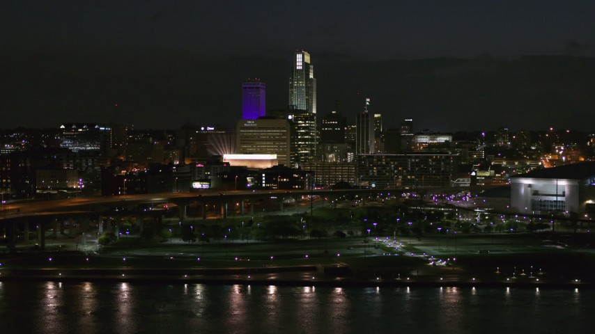 5.7K stock footage aerial video of the city's skyline at night, seen from river, Downtown Omaha, Nebraska Aerial Stock Footage | DX0002_173_032