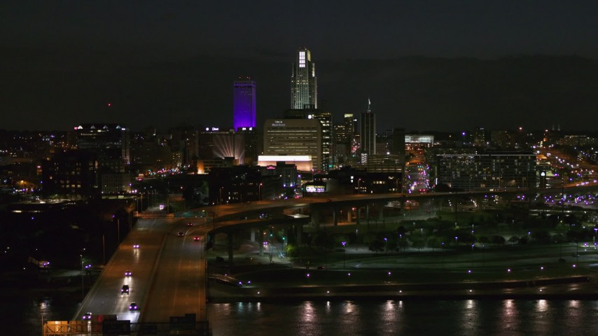 5.7K stock footage aerial video follow bridge to approach the city's skyline at night, Downtown Omaha, Nebraska Aerial Stock Footage | DX0002_173_035