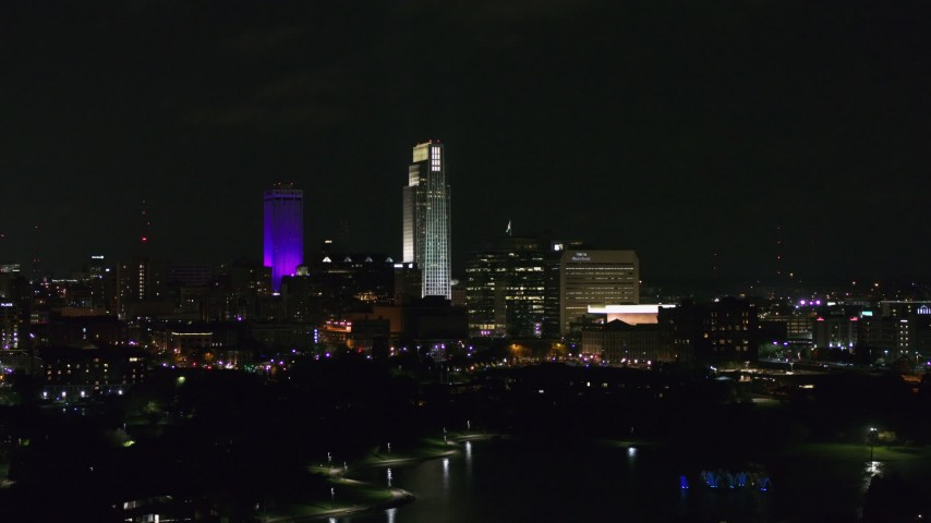 5.7K stock footage aerial video of slowly flying by tall skyscrapers at night, Downtown Omaha, Nebraska Aerial Stock Footage | DX0002_173_039