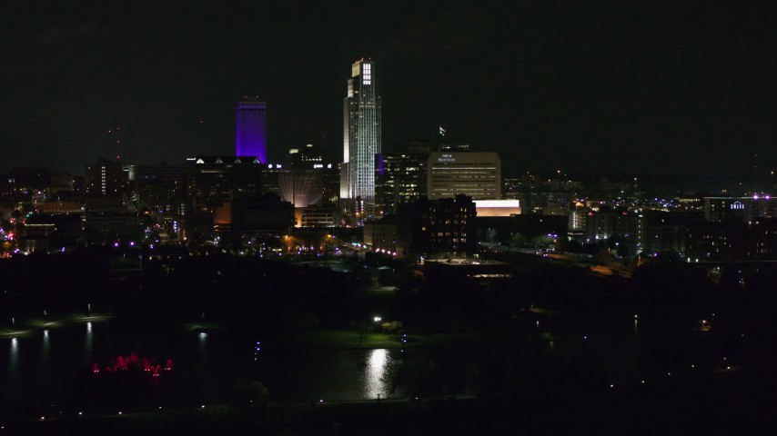 5.7K stock footage aerial video of slowly passing tall skyscrapers at night, Downtown Omaha, Nebraska Aerial Stock Footage | DX0002_173_040
