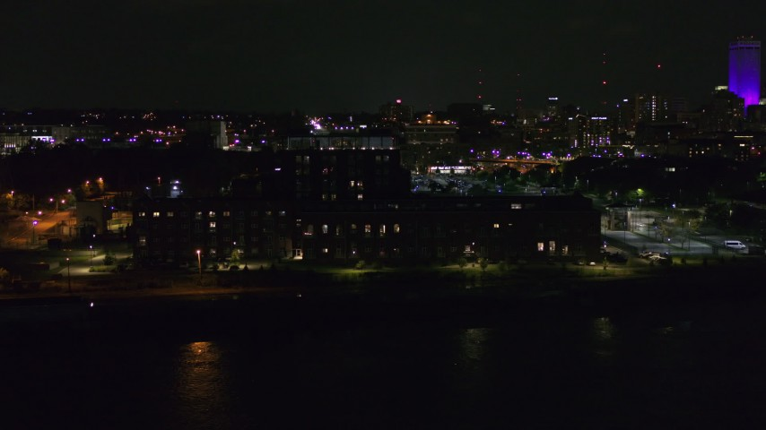 5.7K stock footage aerial video of flying by an apartment complex at night, Downtown Omaha, Nebraska Aerial Stock Footage | DX0002_173_043