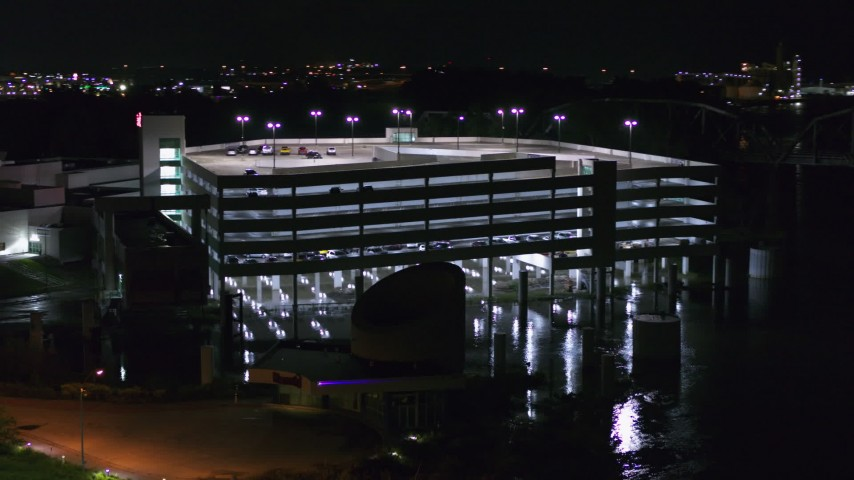 5.7K stock footage aerial video a close orbit of a parking garage at night in Council Bluffs, Iowa Aerial Stock Footage | DX0002_173_044