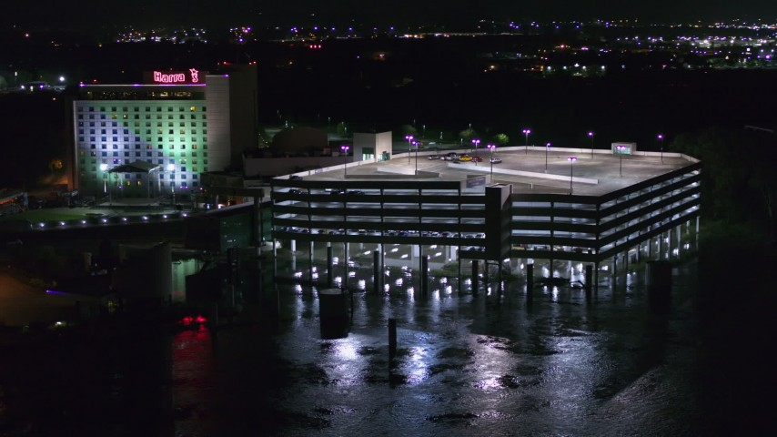 5.7K stock footage aerial video orbit and fly away from parking garage and the hotel and casino at night in Council Bluffs, Iowa Aerial Stock Footage | DX0002_173_046