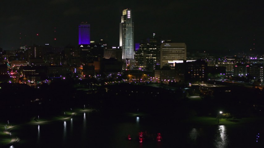 5.7K stock footage aerial video of slowly ascending toward tall skyscrapers at night, Downtown Omaha, Nebraska Aerial Stock Footage | DX0002_173_048
