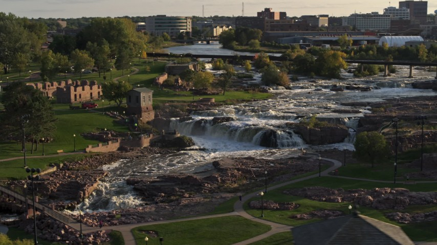 5.7K stock footage aerial video of circling the falls at Falls Park at sunset in Sioux Falls, South Dakota Aerial Stock Footage | DX0002_176_003