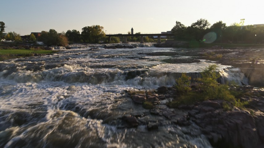 5.7K stock footage aerial video fly over the waterfalls at sunset in Sioux Falls, South Dakota Aerial Stock Footage | DX0002_176_013