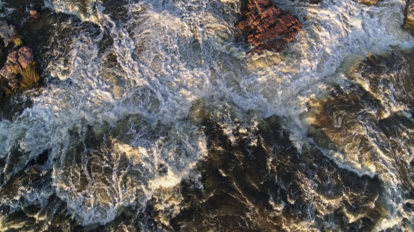 5.7K stock footage aerial video a bird's eye view of the river at sunset in Sioux Falls, South Dakota Aerial Stock Footage | DX0002_176_015