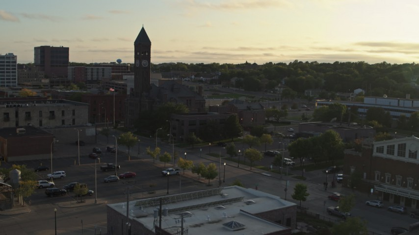 5.7K stock footage aerial video reverse view of the Old Courthouse Museum at sunset in Downtown Sioux Falls, South Dakota Aerial Stock Footage | DX0002_176_023