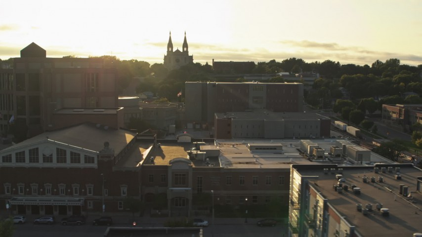 5.7K stock footage aerial video orbit county buildings, cathedral in background at sunset in Downtown Sioux Falls, South Dakota Aerial Stock Footage | DX0002_176_027