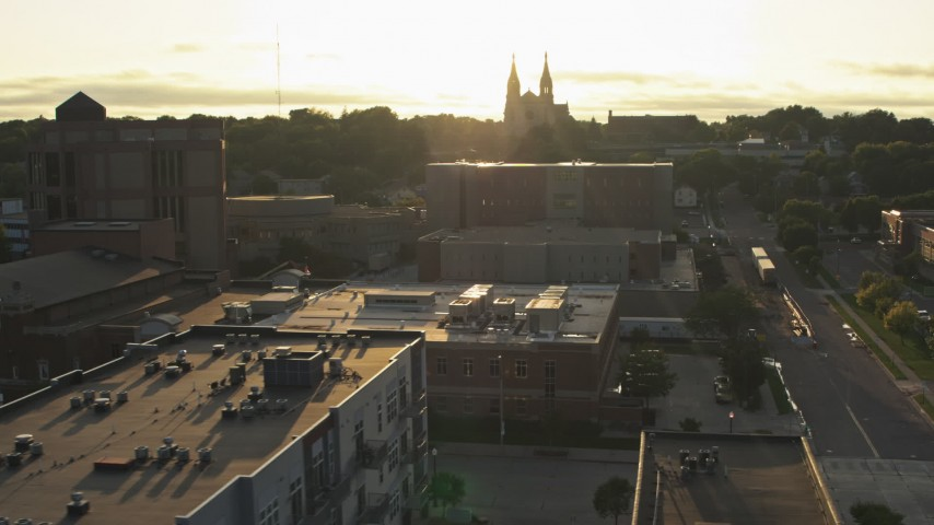 5.7K stock footage aerial video orbit county office buildings, cathedral in background at sunset in Downtown Sioux Falls, South Dakota Aerial Stock Footage | DX0002_176_028