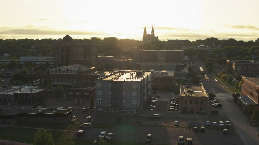 5.7K stock footage aerial video flyby apartment, county office buildings, cathedral at sunset in Downtown Sioux Falls, South Dakota Aerial Stock Footage | DX0002_176_029