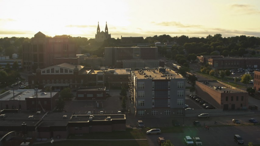 5.7K stock footage aerial video pass by apartment, county office buildings, cathedral at sunset in Downtown Sioux Falls, South Dakota Aerial Stock Footage | DX0002_176_030