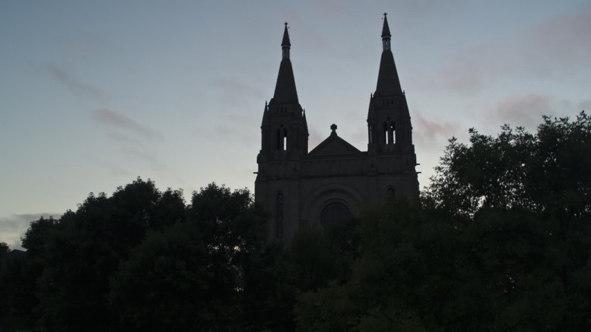 5.7K stock footage aerial video ascend and reveal the Cathedral of Saint Joseph at twilight in Sioux Falls, South Dakota Aerial Stock Footage | DX0002_176_032