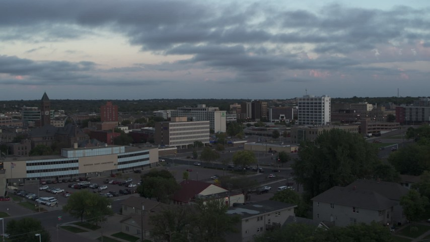 5.7K stock footage aerial video the city's downtown area at twilight, Downtown Sioux Falls, South Dakota Aerial Stock Footage | DX0002_176_033