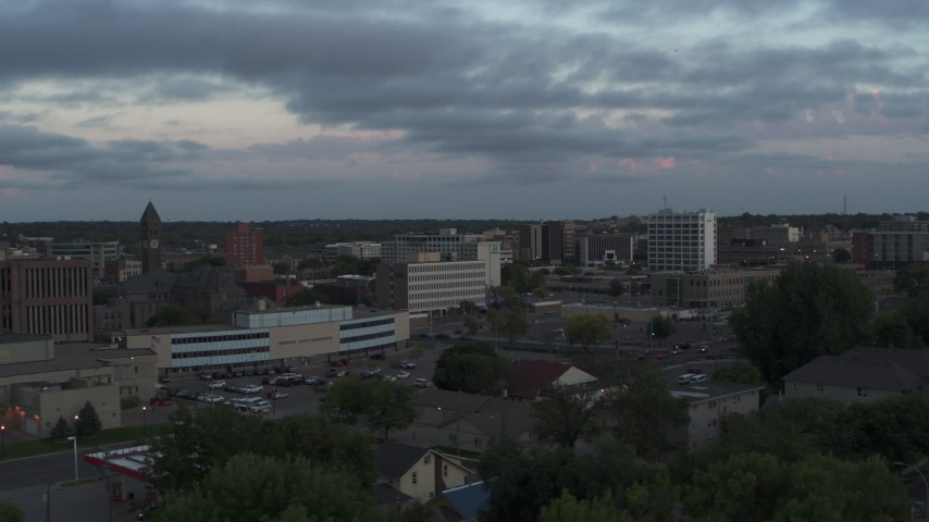 5.7K stock footage aerial video ofpassing by the city's downtown area at twilight, Downtown Sioux Falls, South Dakota Aerial Stock Footage | DX0002_176_035