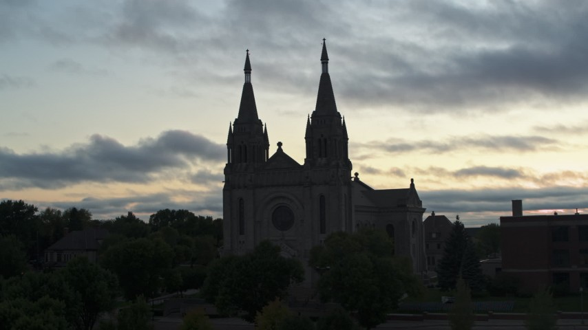 5.7K stock footage aerial video circling the Cathedral of Saint Joseph at twilight in Sioux Falls, South Dakota Aerial Stock Footage | DX0002_176_037