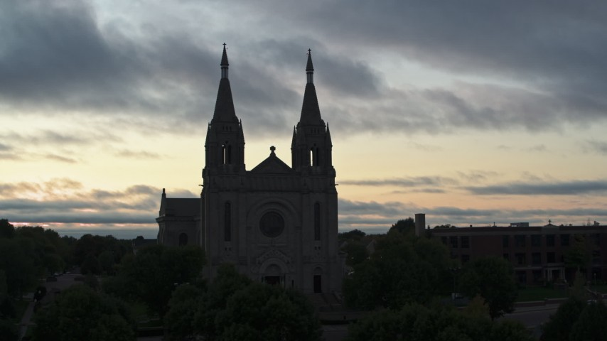 5.7K stock footage aerial video close orbit of the Cathedral of Saint Joseph at twilight in Sioux Falls, South Dakota Aerial Stock Footage | DX0002_176_038