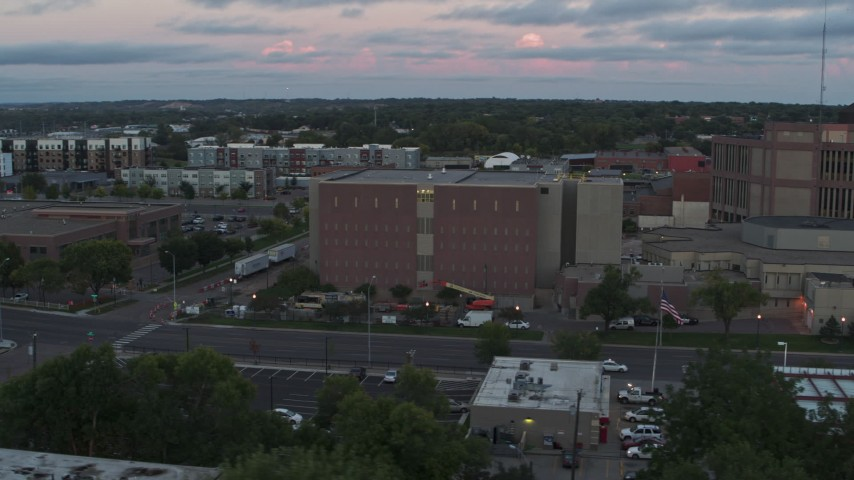 5.7K stock footage aerial video of orbiting a county government building at twilight, Downtown Sioux Falls, South Dakota Aerial Stock Footage | DX0002_176_040