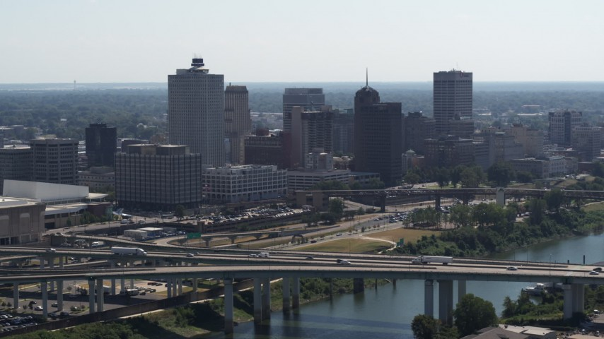 5.7K stock footage aerial video of the city's skyline seen while flying by a bridge in Downtown Memphis, Tennessee Aerial Stock Footage | DX0002_177_003