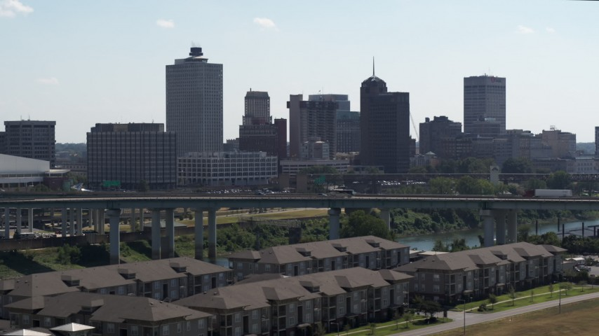 5.7K stock footage aerial video descend with view of the city's skyline and bridge in Downtown Memphis, Tennessee Aerial Stock Footage | DX0002_177_006