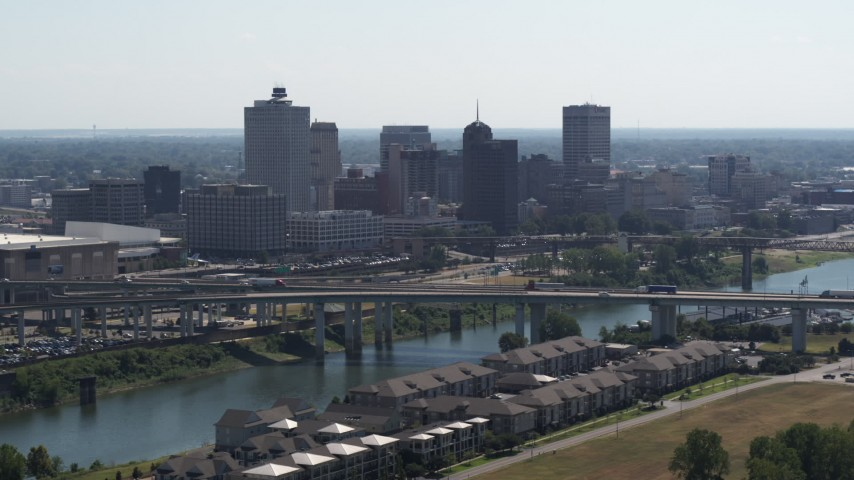 5.7K stock footage aerial video of the city's skyline and bridge spanning the river in Downtown Memphis, Tennessee Aerial Stock Footage | DX0002_177_008