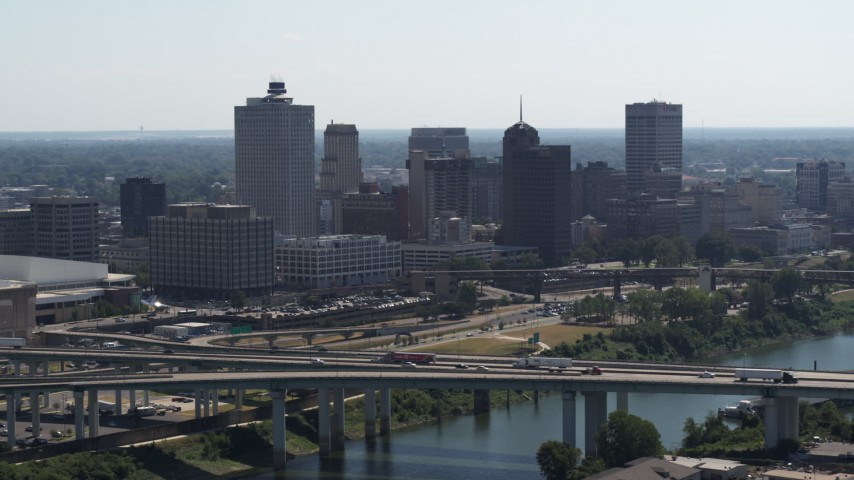5.7K stock footage aerial video flyby and away from the city's skyline and bridge spanning the river in Downtown Memphis, Tennessee Aerial Stock Footage | DX0002_177_009