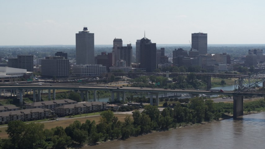 5.7K stock footage aerial video of the skyline while flying by bridge spanning the river in Downtown Memphis, Tennessee Aerial Stock Footage | DX0002_177_012