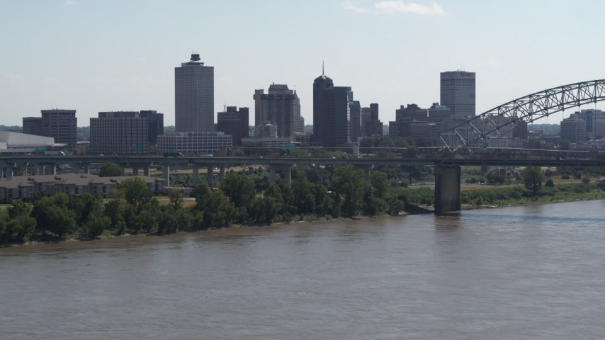 5.7K stock footage aerial video of the skyline and bridge seen from the river in Downtown Memphis, Tennessee Aerial Stock Footage | DX0002_177_013