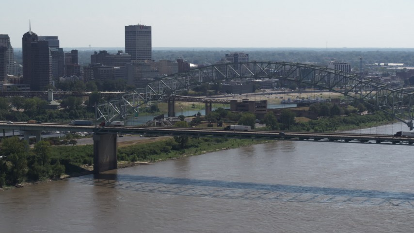 5.7K stock footage aerial video of slowly approach the bridge spanning the Mississippi River, Memphis, Tennessee Aerial Stock Footage | DX0002_177_016