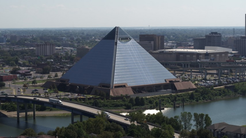 5.7K stock footage aerial video of a reverse view of the Memphis Pyramid in Downtown Memphis, Tennessee Aerial Stock Footage | DX0002_177_019