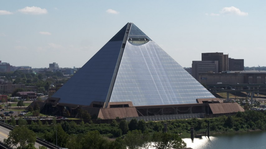 5.7K stock footage aerial video of descending by the waterfront Memphis Pyramid in Downtown Memphis, Tennessee Aerial Stock Footage | DX0002_177_022