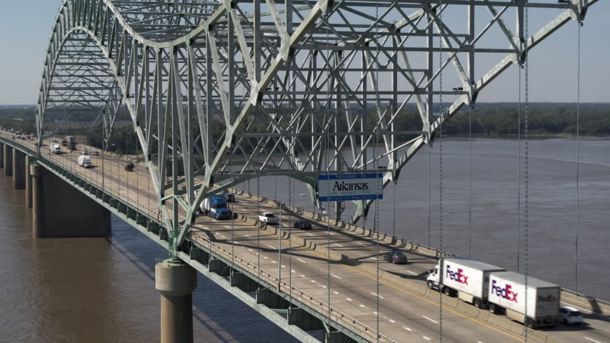 5.7K stock footage aerial video of following cars crossing the bridge under a sign, Memphis, Tennessee Aerial Stock Footage | DX0002_177_029