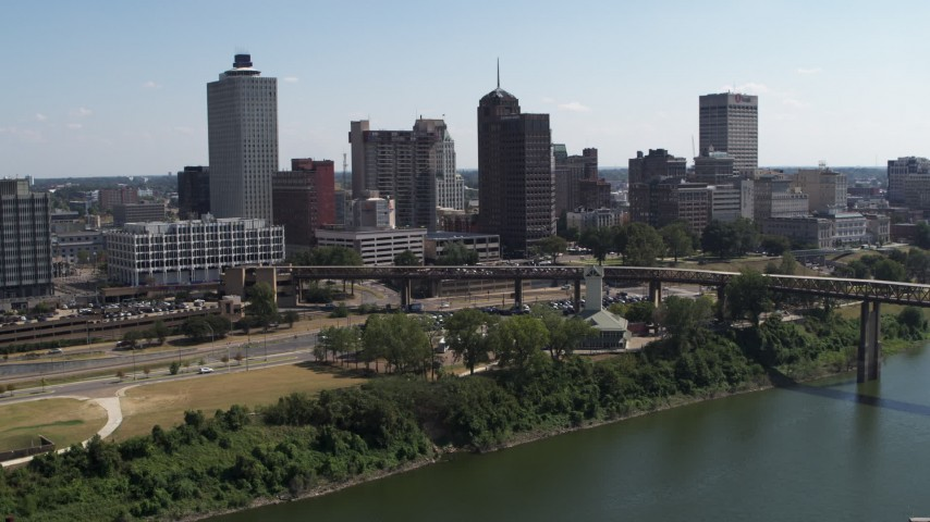 5.7K stock footage aerial video view of the skyline from the river in Downtown Memphis, Tennessee during descent Aerial Stock Footage | DX0002_178_003