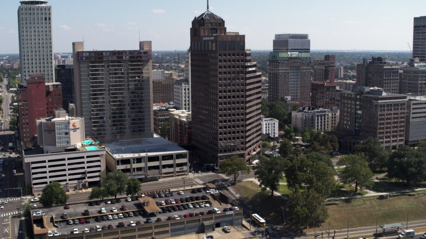 5.7K stock footage aerial video descend and fly away from office towers in Downtown Memphis, Tennessee Aerial Stock Footage | DX0002_178_012
