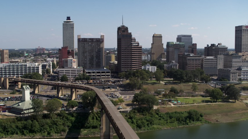 5.7K stock footage aerial video of passing office towers in the Downtown Memphis, Tennessee skyline seen from river Aerial Stock Footage | DX0002_178_015