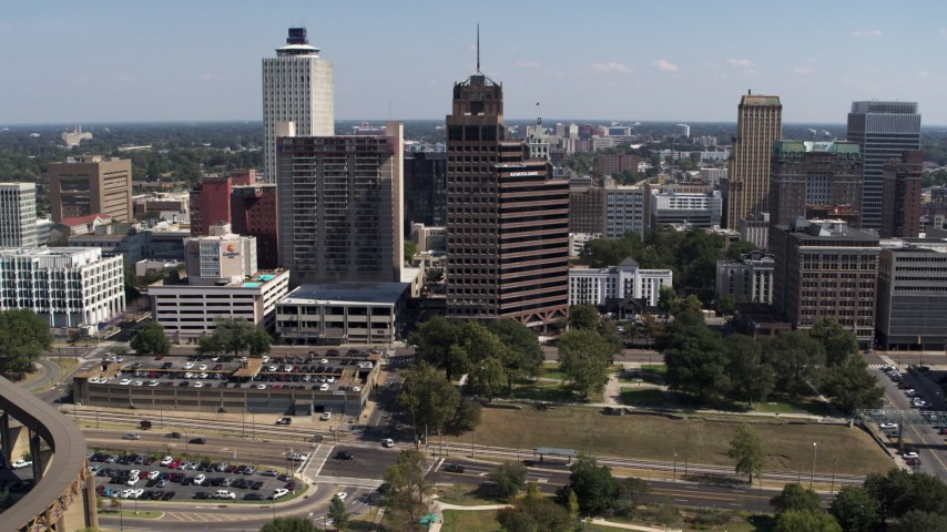 5.7K stock footage aerial video ascend and orbit Raymond James Tower in Downtown Memphis, Tennessee Aerial Stock Footage | DX0002_178_016