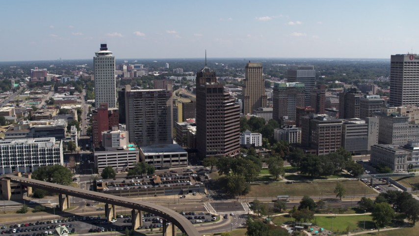 5.7K stock footage aerial video fly away from Raymond James Tower in Downtown Memphis, Tennessee Aerial Stock Footage | DX0002_178_017