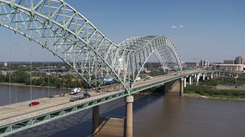 5.7K stock footage aerial video flying by cars crossing the bridge to Memphis, Tennessee Aerial Stock Footage | DX0002_178_021