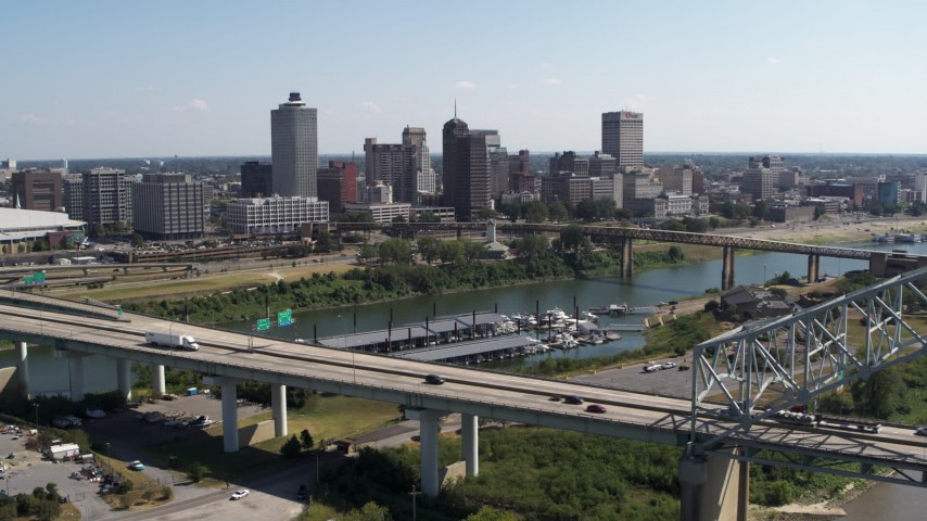 5.7K stock footage aerial video approach the city's skyline from a bridge, Downtown Memphis, Tennessee Aerial Stock Footage | DX0002_178_029