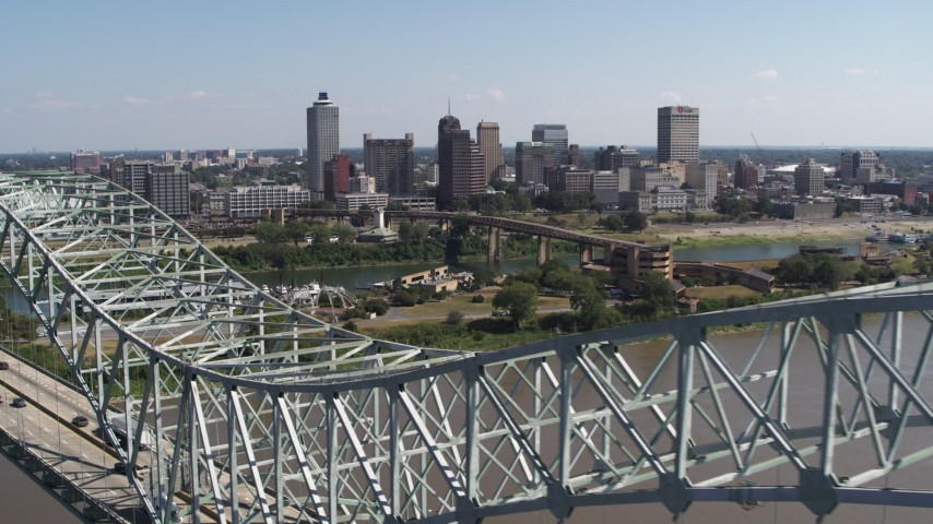 5.7K stock footage aerial video reverse view of the city's skyline seen from the top of the bridge, Downtown Memphis, Tennessee Aerial Stock Footage | DX0002_178_032