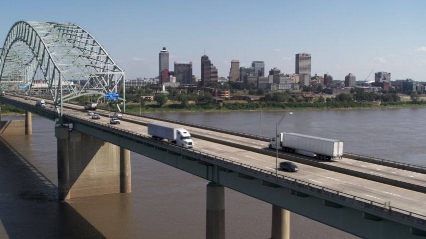 5.7K stock footage aerial video flyby bridge traffic with a view of the skyline of Downtown Memphis, Tennessee Aerial Stock Footage | DX0002_178_033