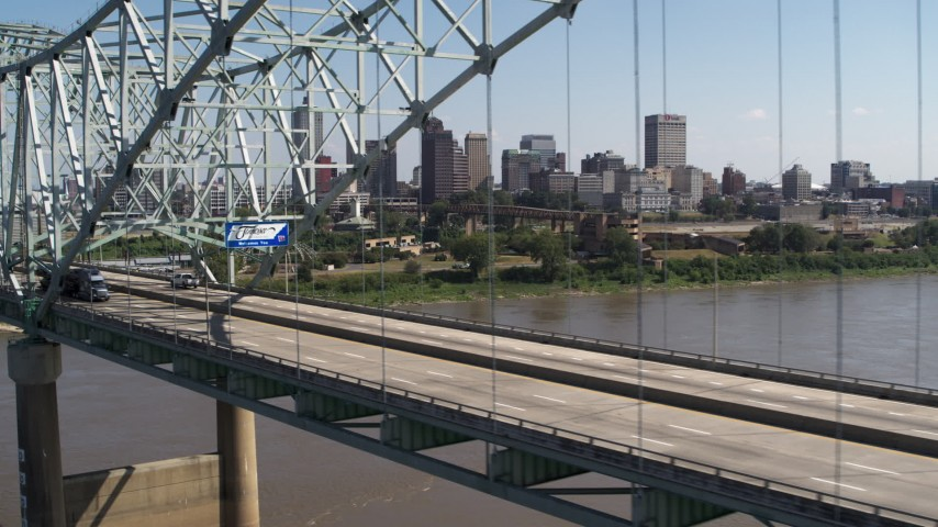 5.7K stock footage aerial video passing bridge traffic with a view of the skyline of Downtown Memphis, Tennessee Aerial Stock Footage | DX0002_178_034