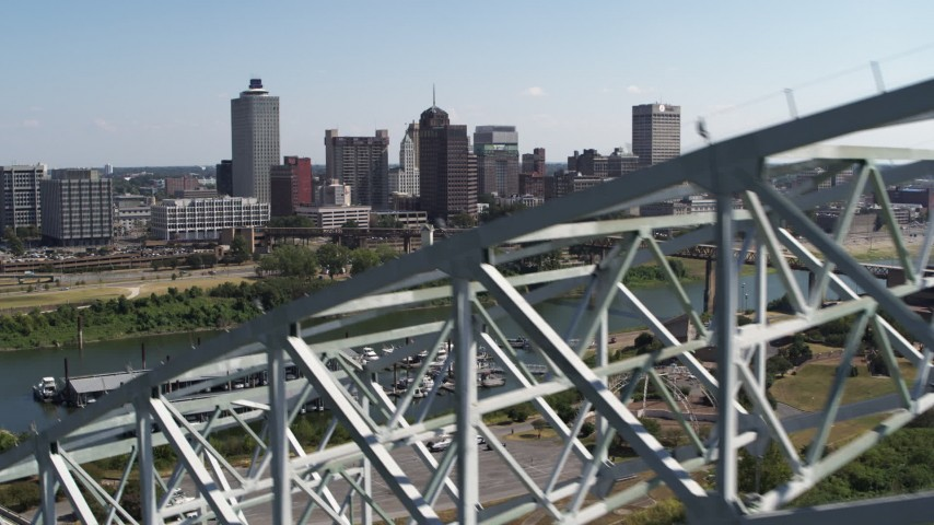 5.7K stock footage aerial video ascend past bridge for a view of the skyline of Downtown Memphis, Tennessee Aerial Stock Footage | DX0002_178_035