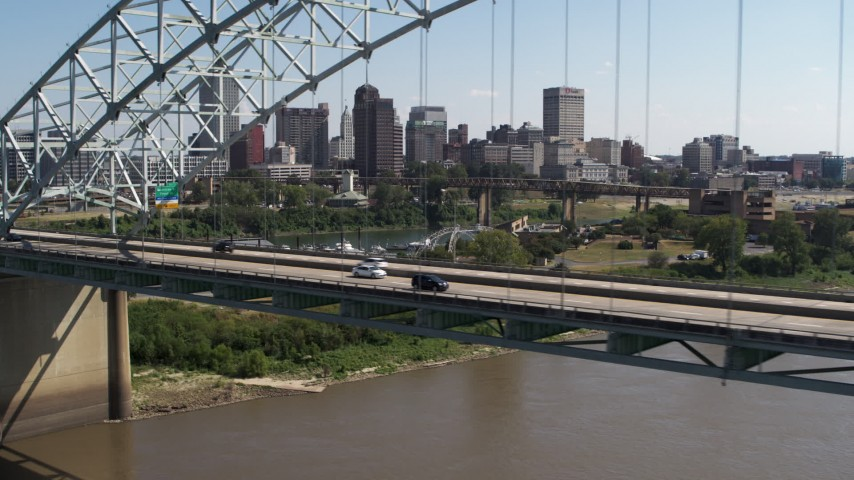 5.7K stock footage aerial video flying past bridge while focused on the skyline of Downtown Memphis, Tennessee Aerial Stock Footage | DX0002_178_036
