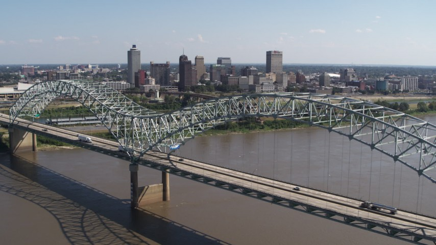 5.7K stock footage aerial video ascending past bridge while focused on the skyline of Downtown Memphis, Tennessee Aerial Stock Footage | DX0002_178_037