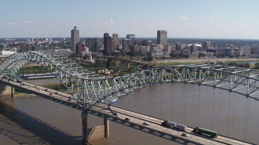 5.7K stock footage aerial video descending past bridge while focused on the skyline of Downtown Memphis, Tennessee Aerial Stock Footage | DX0002_178_039