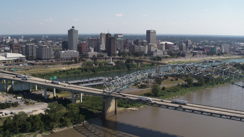 5.7K stock footage aerial video fly away from river to reveal bridge while focused on the skyline of Downtown Memphis, Tennessee Aerial Stock Footage | DX0002_178_041