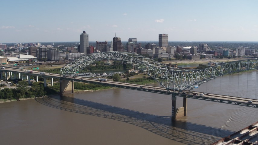 5.7K stock footage aerial video descend with a view of the bridge and the skyline of Downtown Memphis, Tennessee Aerial Stock Footage | DX0002_178_042