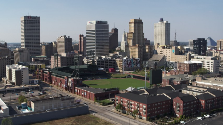 5.7K stock footage aerial video descend with view of tall office towers and a baseball stadium in Downtown Memphis, Tennessee Aerial Stock Footage | DX0002_179_004
