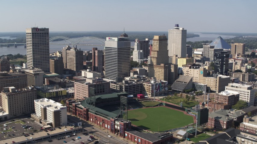 5.7K stock footage aerial video descend with view of tall office towers and a baseball stadium in Downtown Memphis, Tennessee Aerial Stock Footage | DX0002_179_005